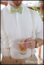 Groom with lime green bowtie and suspenders Infinity Yacht Wedding Michigan Wedding Photographer Photos by Miss Ann