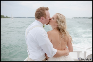 Wedding Day Kiss Couples Portraits Infinity Yacht Wedding Michigan Wedding Photographer